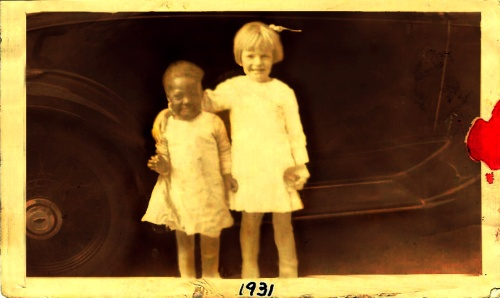 Family photo of Sammy's mother, Audrey, at about age five with unidentified friend in Dothan, Alabama.